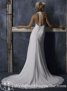 Maggie Sottero Bridal Gown Caprice - A sheath style wedding gown with halter neckline and stunning beaded straps that create a magnificent bar back design.