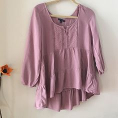 American Eagle Outfitters Top Mauve color tunic that's so adorable. Long sleeves and a gorgeous detailed front chest area. Tiers that show this blouse it's beauty. Color varies from chart. American Eagle Outfitters Tops Tunics