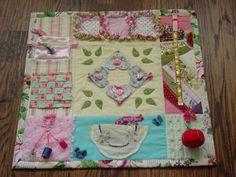 A Fidget Quilt can be used by Alzheimers, Dementia or Brain Trauma Patients. It has attachments to keep restless fingers busy, touching and playing with the items. Items have to be tightly anchored as they will get a workout! Common Items and Textures help to elicit curiosity, memories or awareness in these patients.  I can remember my Grandma picking at her blanket, over and over when she was in the later stages of Alzheimers. I wish we had know about these then!  These Quilts are made with…