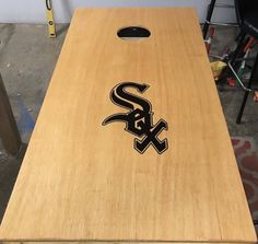 A personal favorite from my Etsy shop https://www.etsy.com/listing/518202004/chicago-white-sox-cornhole-boards-8-bags