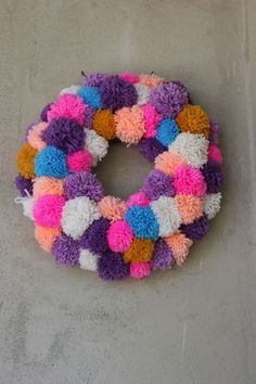 Pom pom wreath- This would be fun to do with Mitchell.  He loves making these pom poms non stop and then I have no idea what to do with them all.  Finally an idea :-)