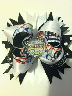 Coach black and white bow $8.00