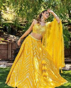 Presenting you latest yellow Lehengas. From light yellow bridal lehengas to pastel yellow bridal lehengas, we have got variety of lehengas #shaadisaga #indianwedding #yellowlehenga #yellowlehengaforhaldi #yellowlehengaforhaldifunction #yellowlehengamustard #yellowlehengacolorcombos #yellowlehengabridal #yellowlehengasimple #yellowlehengalemon #yellowlehengadesigns #yellowlehengapastel #yellowlehengasabyasachi #yellowlehengalight #yellowlehengafloral #yellowlehengalime #yellowlehengaplain #yellow Indian Bridesmaid Dresses, Bridesmaid Outfit, Indian Dresses, Yellow Lehenga, Silk Lehenga, Sari, Mirror Work Lehenga, Yellow Mirrors, Wedding Lehenga Designs