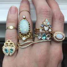 I may have had a little too much fun playing with my rings earlier... Is that even possible? 🤔 #funwithrings #jewelry #rings #pastels #opal #paraibatourmaline #gold #tanzanite #aquamarine #pinktopaz #heart #diamonds #doublefingerring