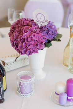 "Wedding decor: www.mipi.lt Photo:www.fotoperlas.lt  Vestuvių dekoras: www.mipi.lt ""Stilingos šventinės dekoracijos"" Nuotraukos :www.fotoperlas.lt  classic wedding, lillac, hydrangea, dessert table, pom poms, levander, table numbers"