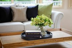 Keep your coffee table decor simple enough that you can still use it!