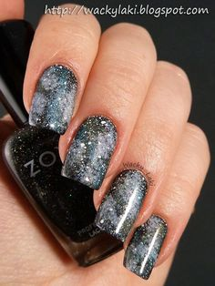 Zoya Storm base; Zoya Megan, Julie, Yara, Noot and Noel sponged on top to create the galaxy. Holographic top coat to give it some shimmer, and white splatter stars using acrylic paint.