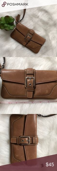 Coach Wristlet Gently used wristlet. This was my go to wristlet before I got the iPhone 7S. (Doesn't fit). Look carefully it definitely has scratches that are typical of coach leather. It's 7inches x 4 inches. Saddle brown. Coach Bags Clutches & Wristlets