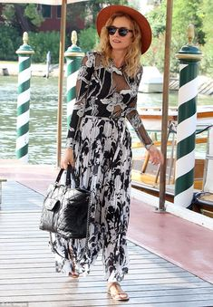 Bold choice: The actress opted to wear two different types of floral prints in black and w...