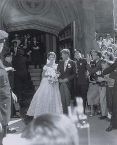 The happy couple can be seen posing for the cameras after tying the knot at St. Mary's Church in Newport, Rhode Island on Sept. 12, 1953.