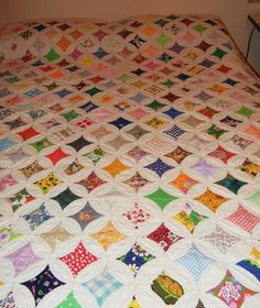 I love the cathedral window quilt. Know how to make them too. Not very hard at all, but takes patience
