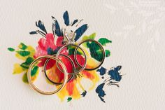 Anna and Spencer Photography, Atlanta Wedding Photographers. Wedding Rings on a Floral Stationery Background.