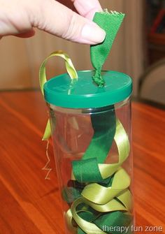 Therapy Fun Zone: Ribbon Pull-activity for fine motor skills. Pinned by SOS Inc. Resources. Follow all our boards at pinterest.com/sostherapy for therapy resources.