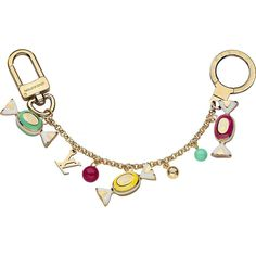 * Golden brass, lacquer and resin * Ring and snap hook engraved with the Louis Vuitton signature * Part of the Delice collection Description: The Delice collection combines the LV logo with adorable candy-shaped charms. This key chain and bag charm is irresistibly fun and feminine.