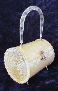 round Lucite 50's purse. One of the prettiest lucite purses I've ever seen!