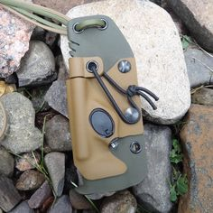 Grizzly Outdoors custom kydex Extreme Neck sheath in Olive Drab and Black with firesteel and button light for Mora, Esee, and Becker Knives