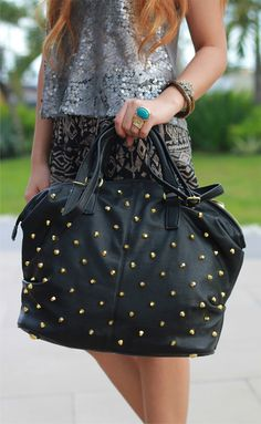 gold spiked black bag
