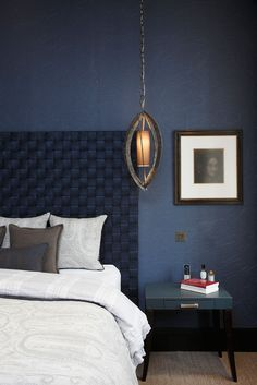 Appropriate midnight blue bedroom with woven headboard