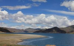 Surrounded by snow-capped mountains, Yamdrok Yso (羊卓雍措, yang zhuo yong cuo) is one of the three largest sacred lakes in Tibet, which is widely considered as the avatar of the female Guardian of Tibet. Yamdrok Lake has many picturesque islands and inlets visible from the road. Visitors could try the circular trek to explore the major promontory into the lake. And the climb up to the glacier Karo La Pass (5054m) will be dramatic, but long.