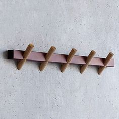 Crosscut Coat Hooks --  Designed by Faudet-Harrison for SCP, England.   $125.00 . Made from a single piece of laser-cut rectangular steel  -- in white or brown -- with five cylindrical oak