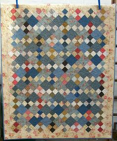 Here's my blue quilt finished. I used a pattern from Back in Time by Renee Plains. I like most of her patterns. Mine ended up looking a bit...