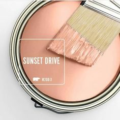 May is the month of warming temperatures and soft pastel coats of blooms on flowering fruit trees. With the wintry chill finally out of the air, going outdoors inspires a soft smile and a sense of relaxation. The gentle pink of Behr's Sunset Drive p