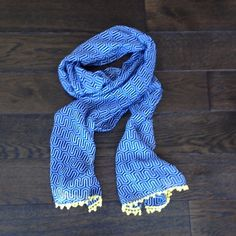 Brilliant Blue & White Print Scarf w/ yellow trim Very nice.  It excellent condition.  Never used.  Very minor pull area (see last photo). Must of happen while in closet because I've never worsen or used.  But again.. Very minor & un noticeable Mudpie Accessories Scarves & Wraps