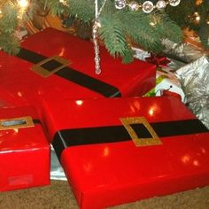 Christmas Gift Wrap Idea.Red paper, black ribbon, gold gift tag. Cut a square in tag thread ribbon then tape on back.