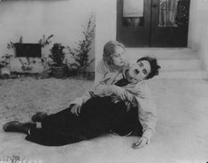 """Charlie Chaplin and leading lady Edna Purviance - """"The Fireman"""" 1916."""