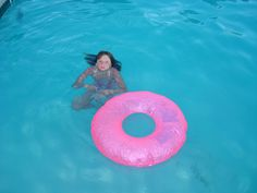 kid swims in pool in blue water