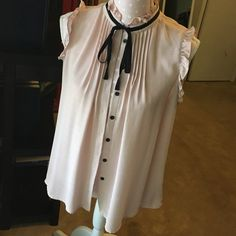 Forever21 Sleeves Bow tie blouse Nude | high collar with black ribbon for bow tie effect | sheer material | sleeveless ruffle | black button down | black discoloration from jacket in pits | make an offer  Forever 21 Tops Blouses