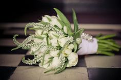 Bridal bouquet with white tulips and veronicas Flowers by Vergeet - My - Nie www.vergeetmynieflorist.co.za