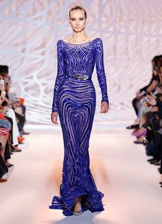 Stunning beaded gown in sapphire blue, with a sheer wave detail. ZUHAIR MURAD