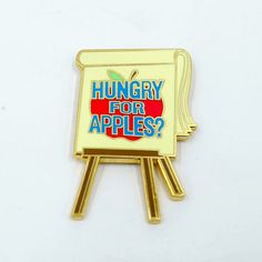 """""""Hungry For Apples?"""" Jerry Smith's terrible advertising campaign from Rick and Morty, pinned. This enamel pin is 1.5"""" tall."""