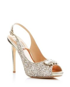 ae3c133a5ef1ec Badgley Mischka s embellished peep-toe sandals light up the night with a  generous coating of sparkly glitter