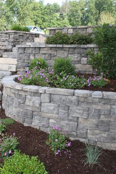 Front Yard Landscaping The Rosetta® Belvedere collection is an ideal choice for garden retaining walls. Featuring multiple unit sizes along with an industry-leading 64 unique stone textures, the Belvedere collection provides an incredibly natural look. Backyard Retaining Walls, Stone Retaining Wall, Retaining Wall Gardens, Retaining Wall With Steps, Retaining Wall Design, Retaining Wall Blocks, Small Front Yard Landscaping, Hillside Landscaping, Landscaping Ideas