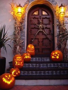 Greet guests with a variety of pumpkin carvings. See more party and Halloween pumpkin carving ideas at one-stop-party-ideas.com