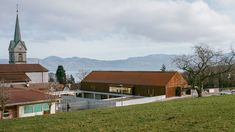 Paris architecture studio Ateliers O-S Architectes has added a concrete and weathering steel extension to a junior school in the village of Lugrin overlooking Lake Geneva. Concrete Bricks, Concrete Structure, Paris Architecture, Contemporary Architecture, Architectural Writing, Larch Cladding, School Equipment, Weathering Steel, Wooden Pattern
