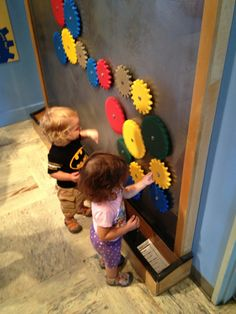 Minnesota Children's Museum: playing with gears on a magnetic board.
