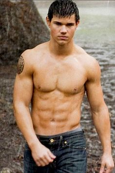 Taylor Lautner as Jacob Black...I'm sure he wasn't the only thing dripping during the filming of this scene Whoops! Did I just say that out loud?!