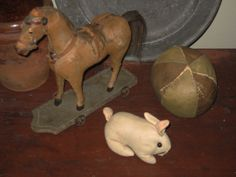 Horse on platform, oil cloth ball and amish bunny.....