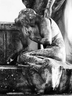 cemetery weeping  statue angel weeps at grave  in  Found in Cemetery de Sant Sebastia, Sitges, Spain.