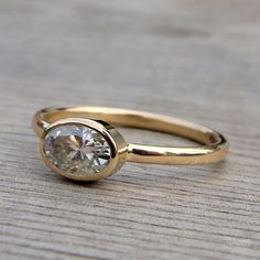 Delicate Oval Moissanite and Recycled 14k Yellow Gold Solitaire Engagement Ring, Made to Order