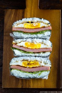 Spam Onigirazu – this Japanese rice sandwich is perfect for a quick meal or snack on the go. The winning combination of fried eggs, sweet sushi rice, and classic spam wrapped up in crunchy nori. You want to sink your teeth into this yummy treat! Spam Recipes, Cooking Recipes, Healthy Recipes, Cooking Tips, Easy Japanese Recipes, Japanese Food, Japanese Musubi Recipe, Hawaiian Spam Musubi Recipe, Japanese Sandwich