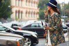 Vividly coloured floral coat ...   (photo by Yu Yang)
