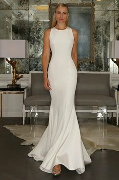 Love the clean lines and simplicity of this form-fitting wedding dress. Would be lovely at an outdoor summer wedding! | Gown by Romona Keveza
