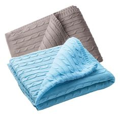 """Stay in and cozy up with the super soft throw.Cable-knit design with a soft touch.FEATURES• 50 """"L x 60 """"WMATERIALS• Polyester/acrylic. Hand wash.Imported."""