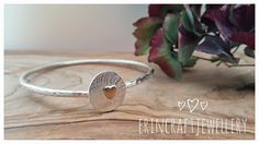 Handmade sterling silver hammered bangle.  Bangle wire used is 2.5cm.  The front of the bangle has an etched sterling silver disc attached and a little gold filled heart added. Please state which size you would like in the drop down menu and it can be made in bright or dull finish.  Please state the finish in your notes. Comes in a lovely white presentation box. See bangle sizing guide. This is a made to measure item.