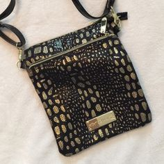Betsy Johnson Cross body Black and Gold animal print cross body with subtle sequins that really glam it up! Main zipper compartment with extra two zipper pockets on each side. Has adjustable strap as well. Bought in Vegas to tote around for the weekend. Like new condition seeing as I only carried it for a few days before switching back to my massive tote bag I lug around everywhere! Betsey Johnson Bags Crossbody Bags