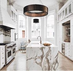 Unique Kitchen Design and Layout. Marble Kitchen Island. White color scheme